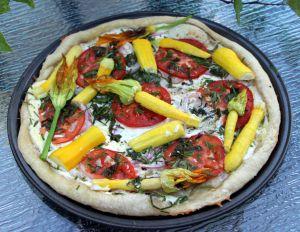 Recette Pizza aux courgettes jaunes et aux fleurs de courgettes