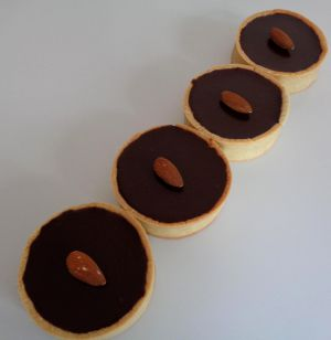Recette Tartelettes praliné amandes et ganache chocolat