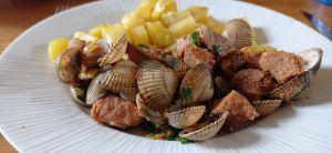 Recette Sauté de porc aux coques ( à l' alentejana)