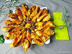 Recette Tarte - Etoile feuilletée à la tapenade noire, aux confits de légumes, aux baies de goji et au curcuma